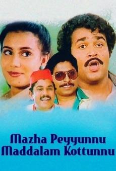 Ver película Mazha Peyyunnu Maddalam Kottunnu