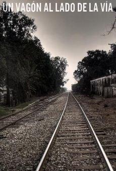 Un vagón al lado de la vía online
